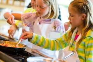 How Kids Cooking Lessons Can Also be Money Lessons: Teaching kids to cook can not only set them up for healthier eating, but give them the skills to keep food spending in check when they're adults.