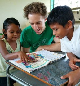 we-co-founder-craig-kielburger-studying-with-children-in-ecuador-credi