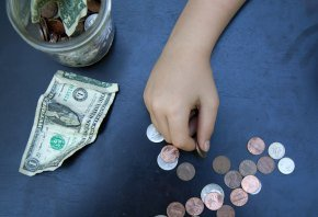 child hand holding money