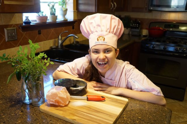 kid-chef-eliana-with-pink-himalayan-salt-rock-and-herbs-from-her-garden-2016-640x425