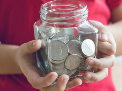 When it comes to teaching kids about money, you may be wondering what to cover. This guide includes everything children need to know about money. #teachingkidsaboutmoney