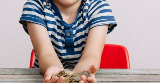 """How to Teach Kids Delayed Gratification in a """"Buy Now, Pay Later"""" World: Learning how to delay gratification and instead save money is one of the most important skills kids need to become financially secure adults. Here's how parents can nurture a delayed gratification mindset in their kids."""