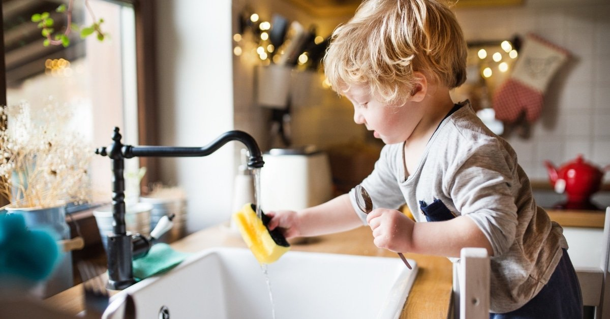 toddler washing dishes, doing chores