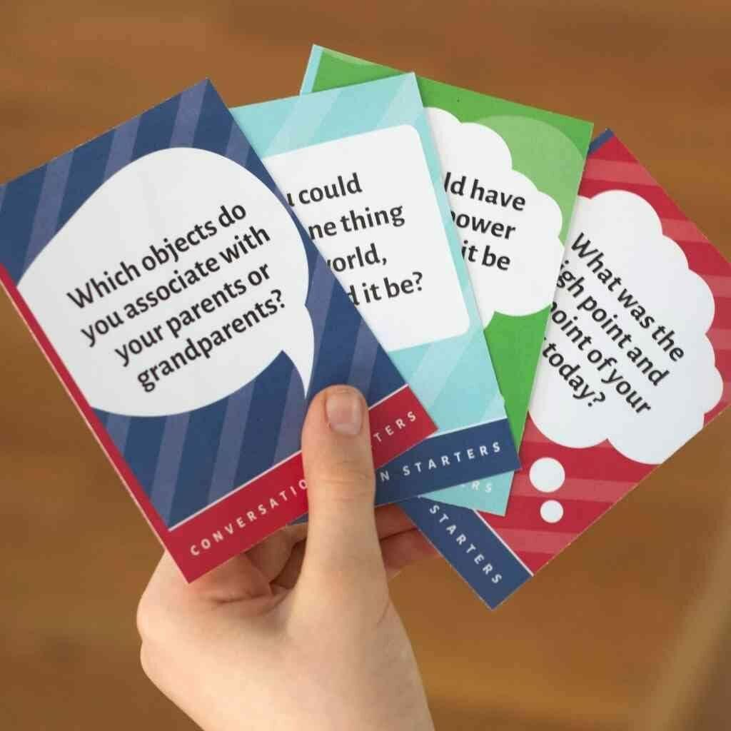 hand holding conversation starter cards